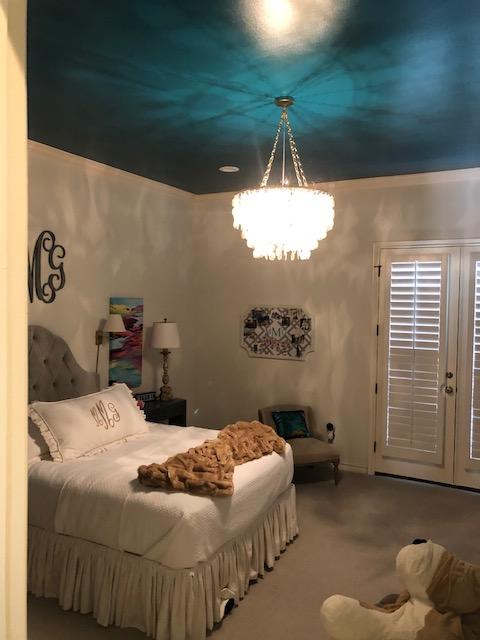 Dark ceiling paint in a bedroom.